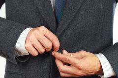 Man fastened the buttons on his business suit closeup Stock Images
