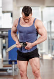 Man fastening belt in the gym Stock Photos
