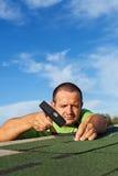 Man fastening bitumen roof shingles Stock Photos