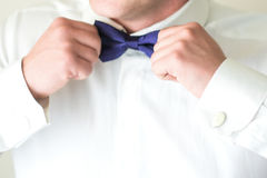 Man fastening a bow tie Stock Photography