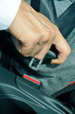 Man fastening the car safety belt Royalty Free Stock Photo
