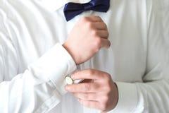 Man fastening a cuff Stock Photo