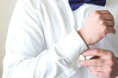 Man fastening a cuff Stock Image