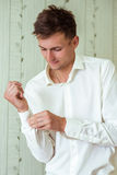 Man fastening a cuff Royalty Free Stock Photo