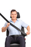 Man fastening his seat belt on a car seat Stock Photo
