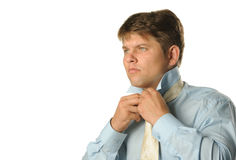 The man fastening necktie Royalty Free Stock Photo