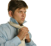 The man fastening necktie Stock Images