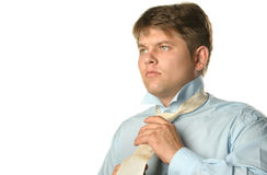 The man fastening necktie Stock Photography