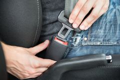 Man fastening seat belt in car Royalty Free Stock Images
