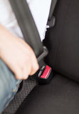Man fastening seat belt in car Royalty Free Stock Photography