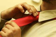 Man fastening tie Stock Photos