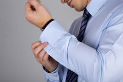 Man fastens his cuff links close-up Stock Image