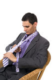 Man fastens a tie royalty free stock photos