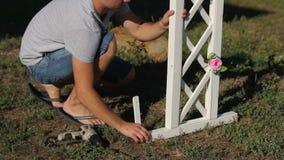Man fastens a wedding arch stock footage