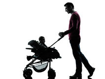Man father with baby carriage silhouette Royalty Free Stock Photo