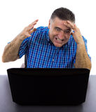 Man fault of the laptop. Angry businessman through the fault the laptop Stock Images
