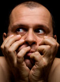 Man in fear. Portrait of adult man in fear on black background stock photography