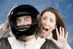 Man and fearful woman on a motorcycle Stock Photography
