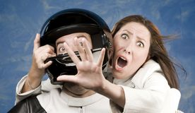 Man and fearful woman on a motorcycle Royalty Free Stock Images