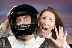 Man and fearful woman on a motorcycle Royalty Free Stock Image