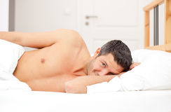 Man in feather bed - the awakening Royalty Free Stock Photos
