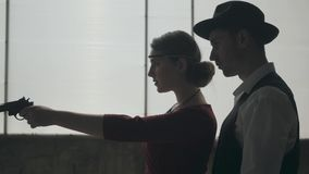 Portrait man in fedora hat, classical suits and woman in style cloth dancing in dirty place. Abandoned dilapidated. Man in fedora hat, classical suits and woman stock video