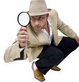 Man with fedora hat and magnifier. On isolated background stock image
