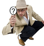 Man with fedora hat and magnifier Stock Photos