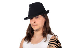 Man with fedora looking serious Stock Photos