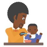 Man feeding baby. Royalty Free Stock Photo
