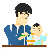 Man feeding baby. Stock Photo