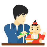 Man feeding baby. Royalty Free Stock Image