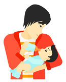 Man feeding baby. Stock Images
