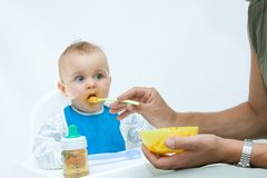 Man feeding baby with a spoon Royalty Free Stock Photo