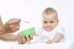 Man feeding baby with a spoon Royalty Free Stock Image