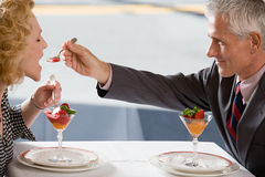 Man feeding dessert to woman Royalty Free Stock Photos