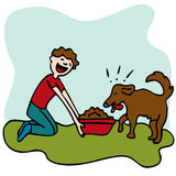 Man Feeding Dog Food Royalty Free Stock Images