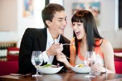 Man Feeding Girlfriend Stock Photo