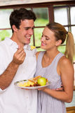 Man feeding girlfriend Stock Photo