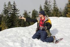 Man Feeding a Grey Jay on his Hand on Mount Seymour Stock Photography
