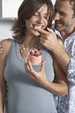 Man Feeding Happy Pregnant Woman Strawberry Shortcake Royalty Free Stock Image