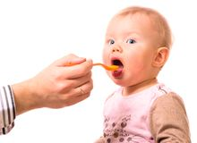 Man is feeding his baby. With a spoon Royalty Free Stock Images