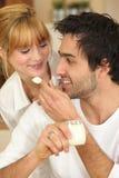 Man feeding his girlfriend Stock Photo