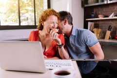 Man feeding wife with croissant Stock Image