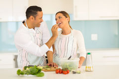 Man feeding wife Stock Image