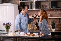 Man feeding wife with strawberry Royalty Free Stock Photos