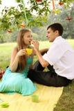 Man feeding a woman Royalty Free Stock Image