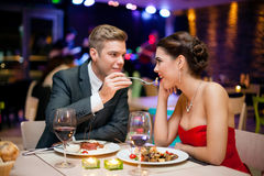 Man feeding woman Royalty Free Stock Photo