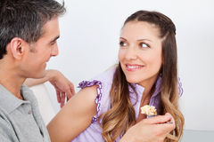 Man feeding woman with cereal Royalty Free Stock Images
