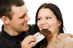 Man feeding a woman chocolate . Stock Photography